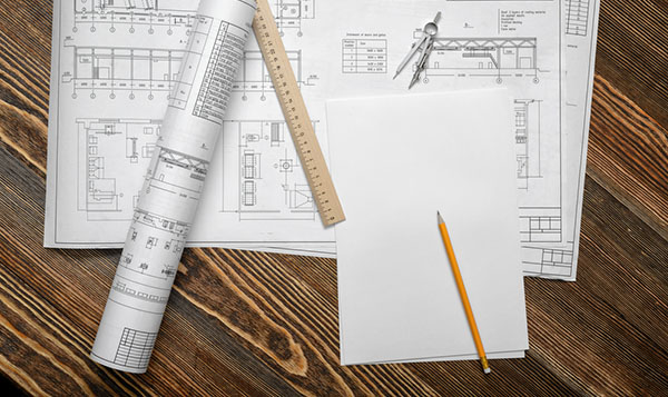 building permit and blueprints on table