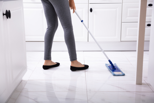 Mopping white marble floor