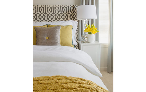 bed with yellow throw blanket